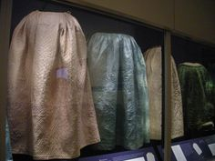 Quilted petticoats from Colonial Williamsburg's DeWitt Wallace Museum. Photo from A Fashionable Frolic's Flickr page. fashionablefrolic...