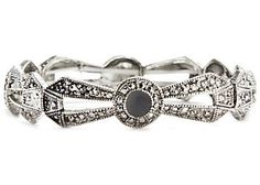 Add elegance to that special occasion with this 7½'' stretch bracelet that features shiny jet marcasite set in silver tone metal.