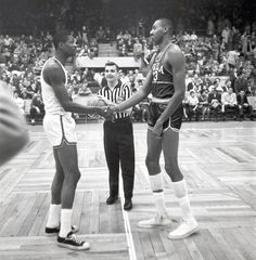 Bill Russell and Wilt Chamberlain shake hands before their first NBA game against one another, Nov. 1959. | theScore.com