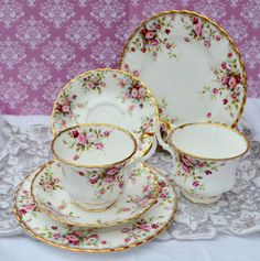 Vintage bone china tea trios made by Royal Albert in the English china factory during the 1980s. The trios consist of a pair of tea cups,