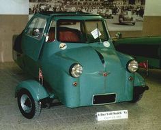 The Felber Autoroller T 400 was a three-wheeled micro car with a rear-mounted 398 cc Rotax two cylinder, two stroke engine. The cars had an unusual seating arrangement, with a small child-sized seat behind the driver on the left and a conventional passenger seat diagonally behind and to the right. From 1952 to 1953, about 400 units were built in two versions, all of which were painted light green using a standard paint then used for machinery which was cheaper than car paint.