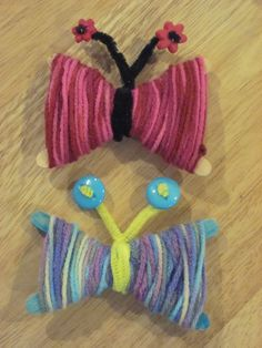 Yarn butterflies-popcicle sticks, pipecleaners and buttons!
