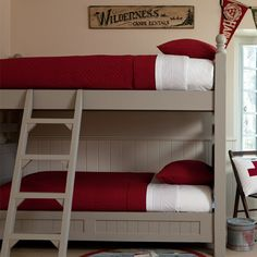 Red quilted bunk beds. The neatness of these beds reminds me of my grandmother.