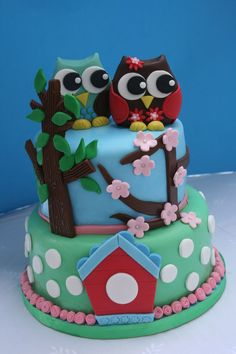 Two tiered carrot cake birthday cake for a boy and a girl. Owls made out of fondant as were all the other decorations