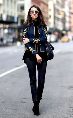 Tailored from Street Style at New York Fashion Week Fall 2016  Thania Peck was seen on the streets of New York City wearing a military-inspired blue and gold jacket, gray denim jeans and, of course, black booties.