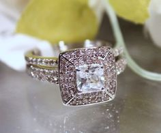 Stones : Cubic Zirconium  Color: Clear  Setting: Stainless steel  Main Stone :5.5x5.5 mm / 1 Carat  Accent Stones: 1.5 mm  Shape: Princess/ Round  Total Carats: 3.2 Carats  Ring Weight: 5.3 Grams  This ring set is Exquisite with the top notch workmanship shown in this set.  I am sure you...