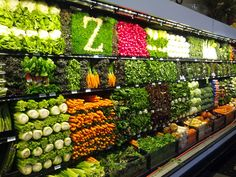 goabroadd:    thingsorganizedneatly:    ed: I get a lot of produce aisle submissions, but this is the most impressive one I've seen. Look at that celery grid, bottom left of the photo. And the Z at the top is above and beyond! Bravo, Zupans.   Thanks to Public Planet for the tip.    love this place