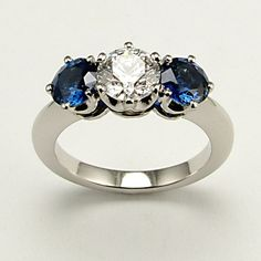 0.70ct GIA D VVS2 Round Brilliant-Cut diamond flanked by two perfectly matching sumptuous blue sapphires of 0.60cts each. Perfectly set into this classic trilogy style ring entirely handmade in platinum.
