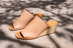 Delicious....Description:  A beautiful open toe, low wedge in Polished Clay leather. High coverage  upper and wood wedge. Leather sole.  Fits true to US sizing.  Designer:  Rachel Comey  Details:  Made in Peru 100% Cow Leather Upper/ 100% Cow Leather Sole 50 mm heel height