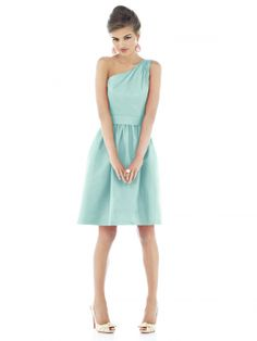 Cocktail length one shoulder dupioni dress w/ matching wide self belt at natural waist. Full shirred skirt has pockets at side seams. Also available full length as style D529.
