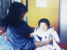 Atsushi Sakurai and a baby. Buck-Tick