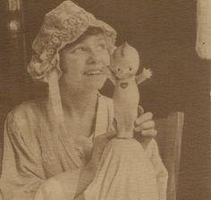 vintage portrait - girl with kewpie doll