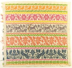 00116 Pattern Darning Panel  Mexican, circa 1910  Handwoven fabric panel worked in counted thread and pattern darning with color bands in floral and animal motifs worked in orange, salmon, yellow, green, blue and violet.  16 x 16.5 in (40.6 x 41.9 cm)