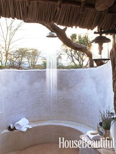 An outdoor shower with a view. Design: Suzanne Kasler. housebeautiful.com. #outdoor_shower #shower #kenya #thatch
