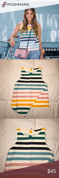 Zara Multi Color Striped Sleeveless Top XS Multi color striped top. Sleeveless. Zipper closure. Asymmetric hem. Size XS. Polyester. **care tag was taken off** measured across: shoulder to shoulder 11in, armpit to armpit 16in, waist 16in, length 20in Zara Tops Blouses