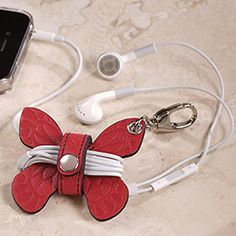a stylish way to tame the earbuds. I like the idea behind it, but maybe something other than a butterfly.