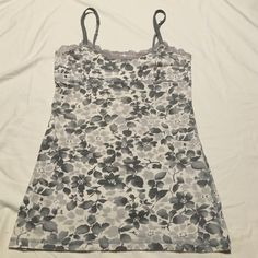 Very pretty American eagle outfitters tank top Very pretty American eagle outfitters casual tank top. Lace trim on top. Grey and white, Size M. Excellent condition. Great for the summer or to throw over a bathing suit. Super cute. American Eagle Outfitters Tops Tank Tops
