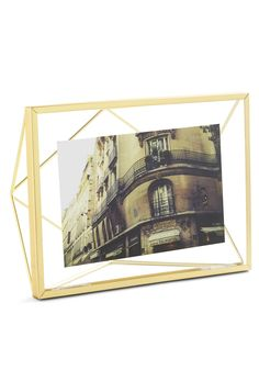 Memorable Dimension Frame. Just as memories float in your mind, so do your most-treasured photographs suspend when displayed in this prism-shaped picture frame. #gold #modcloth