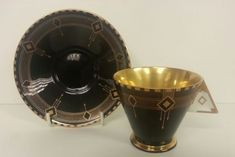 A Rare Shelley Art Deco Vogue Shape Coffee Cup and Saucer, pattern # 11897. Extremely Rare Black Diamonds. British C 1931.