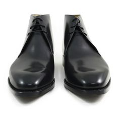 This pair is for those guys who are looking for a pair of chukka boots to wear with business suit. The pair is made of black calf leather elegant and features sleek shape with the merest hint at a chiseled toe. An elegant boot by Spanish maker Carlos Santos.