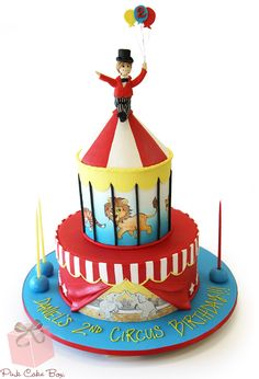 Daniel's 2nd birthday circus themed cake! We recreated the likeness of Daniel as the ringmaster sitting atop of the peak of the top tier.  The cake also includes hand painted drawings of a lion, tiger, leopard and elephants.  Happy 2nd Birthday Daniel!
