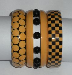 Fabulous vintage bakelite checkerboard and random dot bracelets. Love the contrast of black and ivory together!