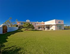 The Ultimate Party House! The Glebe House is set on top of a hill in the prestigious Tuckers Town area with commanding panoramic views. The grand entrance leads down a gracious stairway to the magnificent Great Room with high ceilings and elegant fireplace. On this level is also a comfortable library with fireplace, fully equipped wet-bar, dining room which is set in a Bermuda stone grotto on a curve, and a large modern kitchen with a breakfast nook built into a bay window. Upstairs in the…