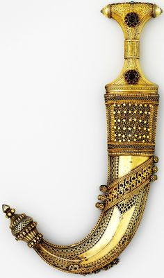 Arabian jambiya dagger, 18th century, steel, silver, wood, leather, textile, turquoise, emerald, glass, ruby, H. with sheath 12 3/4 in. (32.4 cm); H. without sheath 11 1/16 in. (28.1 cm); W. 2 7/8 in. (7.3 cm); Wt. 9.1 oz. (258 g); Wt. of sheath 13.7 oz. (388.4 g); case (c); H. 14 in. (35.6 cm); W. 3 1/2 in. (8.9 cm); Wt. 10.8 oz. (306.2 cm), Met Museum.
