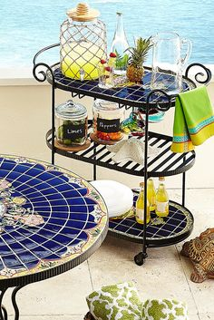 Pier 1's Rania Serving Cart does far more than serve. It gives you a hand—handcrafted, hand-painted, hand-forged, hand-set ceramic tiles and hand-adjustable casters. With its vibrant colors, global-inspired design and three shelves, it's a great way to make your potables portable.