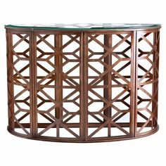 An eye-catching addition to your living room or foyer, this artful console table features a stylish openwork base and chic glass top.  ...