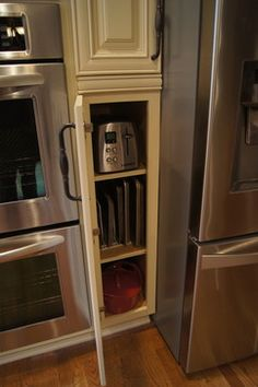 Side pantry cabinets allow for small appliance storage, and baking storage. Pantry items can be stored as well. These pantry cabinets frame the refrigerator.