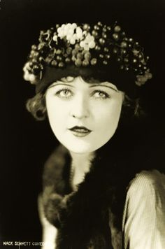 Make up - dark lips accentuate the cupids bow, mascara, eye liner and drawn on long thin eye brows...      Phyllis Haver, 1920s