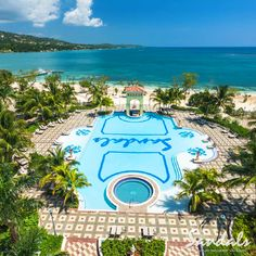 Jamaica's largest pool is framed by a sprawling piazza and is just steps from the beach. | Sandals Resorts | Jamaica