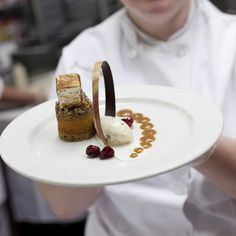 Sweet Potato Pecan Pie with Brown Butter Pecan Ice Cream, Candied Cranberries, a Bourbon Caramel Sauce, and a Cinnamon Marshmallow. Made by students in our Restaurant Productions Desserts class!