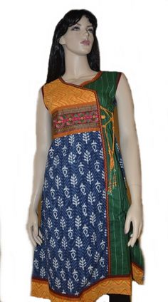 The body of the kurta comes in combination of batik effect cotton fabric as well as plain cotton anchor stitch fabric. The yoke of kurta has a jacquard cotton fabric with embroidered lace and hand embroidery at neckline and beautiful mirror work.