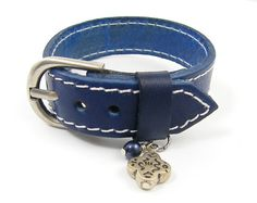 Blue Leather Bracelet Leather Cuff Bracelet by CharleneSevier, $12.00    Blue leather cuff bracelet. Bracelet has white stitching around the edges and is accented with two beads - one silver tone; the other a navy blue crystal pearl.    #jewelry #bracelet #boho #cuff #leather
