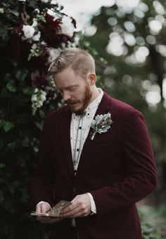 longhorn skull guest book groom's style wedding embraced their love relaxed eclectic imagery and totally personalized details couple tied knot at Skelly Lodge rural Oklahoma venue hunting lodge bluff overlooking river valley, and encouraged their guests Halloween costumes as the wedding spooky holiday. super cool groom mix-and-match maroon navy blue suit patterned shirt custom octopus bolo tie Rue De Seine gown faux fur jacket totally boho feminine flair junebug