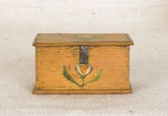 "Sold For $1,900         	   	        	   	           	      	                  Jonas Weber, Lancaster County, Pennsylvania, ca. 1840, decorated trinket box with a stylized tulip and leaf decoration on a yellow ground, 2 1/4'' h., 4'' w., 2 1/4'' d. Provenance: Stanley Todd sale, May 1966.                            Condition report           1/2"" loss to back edge at inside hinge. Surface abrasions."
