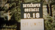 1966: Skyscraper obstacle course wooden climbing tower structure. U.S. AIR. http://www.pond5.com/stock-footage/58953847?ref=StockFilm keywords:On base, outdoors, military, training, family day, friends, show off, proud, closed, not in use, abandoned, climbing structure, uniformed, Colorado, Colorado Springs, USA, Air Force, Air Force Academy, exercise, lifestyle, obstacle, 1966, Skyscraper, course, wooden, climbing, tower, structure