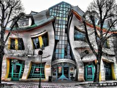 The Krzywy Domek is an irregularly-shaped building in Poland