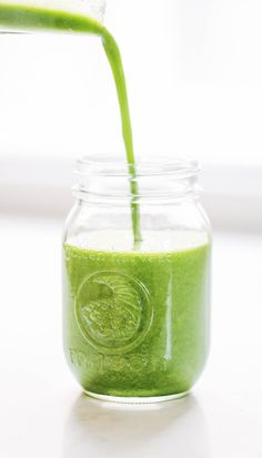 Pouring a green smoothie