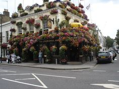 """Fullers Pubs, Restaurants and Taverns: Shown here is their Churchill Arms Pub & Tavern in the Kensington area of London England.  A beautiful and great example of """"Business Curb appeal"""" at it's finest and what we call a """"ParadeOfGardens""""!"""