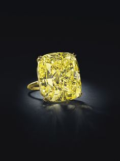 75.56-carat cushion modified brilliant-cut Fancy Vivid yellow diamond