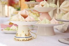 Vintage china teacup and saucers. Invert them and you have a mini cakestand for a dessert table. Pretty and creative.  www.vintagedishrental.com