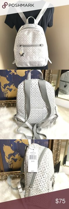 """Tommy Hilfiger Gray Backpack Silver Tone Brand New With Tag....Always Guaranteed To Be 'AUTHENTIC'  ITEM DESCRIPTION:  TOMMY HILFIGER Woman's Small Backpack Style # 6939070091 Color : Gray and Silver Exterior ~ Fabric wFaux Leather Trimw/, Silver Tone Hardware, 1 Zip Pocket Interior ~ One Compartment Measurement Approx : Small sized bag; 10-1/2""""W x 11-1/2'H x 5-1/2""""D MSRP $89.00 Tommy Hilfiger Bags Backpacks"""