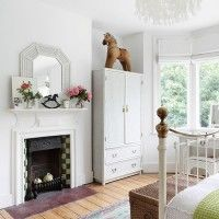 A White Scheme Emphasises This Traditional Bedroomu0027s Period Fireplace And  Wood Floorboards.