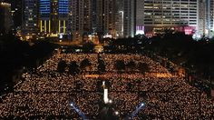 More than 150,000 people took part in candlelight vigils Saturday in Hong Kong to commemorate the bloody 1989 crushing of democracy protests at Tiananmen Square in Beijing.
