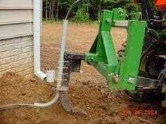 Homemade cable laying attachment for a subsoiler, constructed from an L-shaped section of conduit. 3 Point Hitch Attachments, Compact Tractor Attachments, Skid Steer Attachments, Small Tractors, Compact Tractors, Lawn And Garden, Garden Tools, Welding Table Diy, Welding Cart