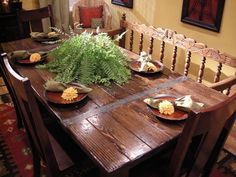 DIY Dining Table. Well not sure I'd MAKE it myself, but a very cute rustic idea. Find an old table, refinish, find some chairs and a bench, VOILA!