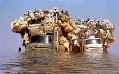 Heavy loaded truck crossing the water, Pakistan